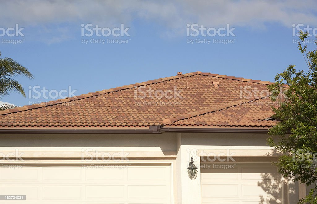 Stucco Home Exterior Tile Roof and Blue Sky royalty-free stock photo