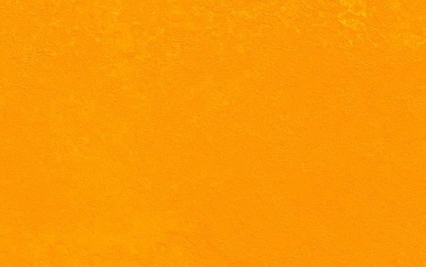 stucco orange or jaune moutarde decannelle citrouille automne texture pierre mur abstrait bright sandstone beach desert contexte - état solide photos et images de collection