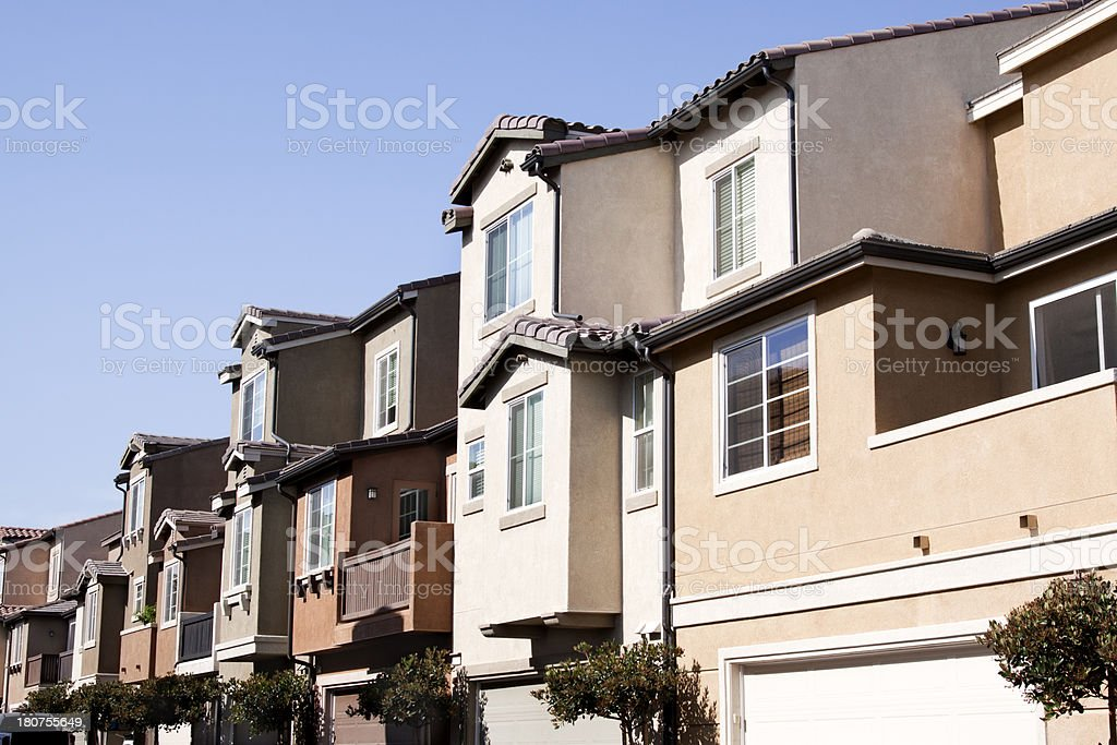 Stucco Townhouse Exteriors and Blue Sky royalty-free stock photo