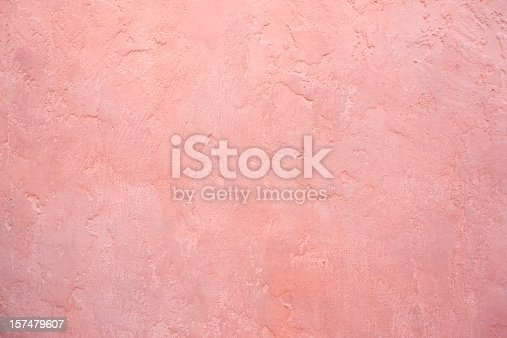 Pink stucco wall background.