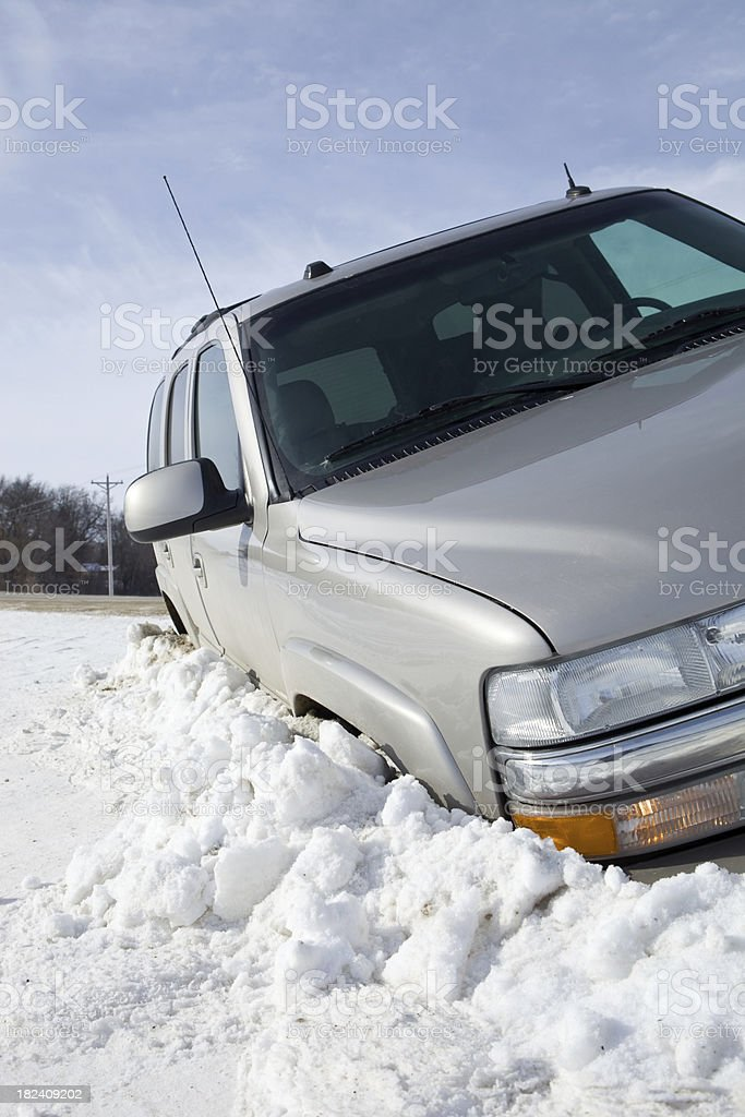SUV Stuck in a Winter Ditch royalty-free stock photo