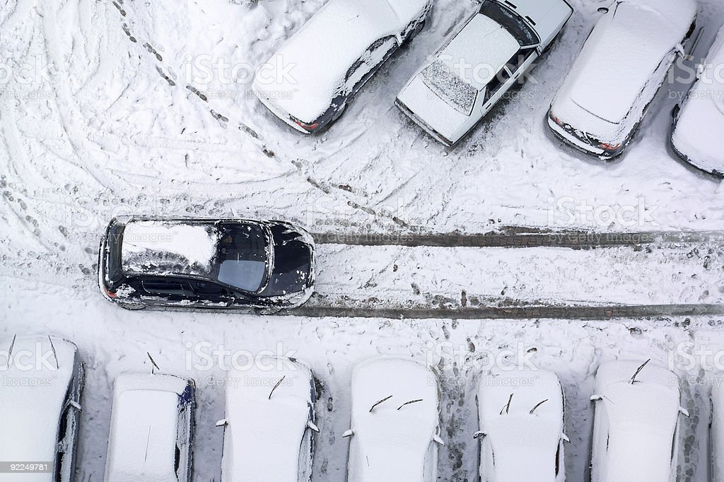 stuck in snow covered parking lot royalty-free stock photo