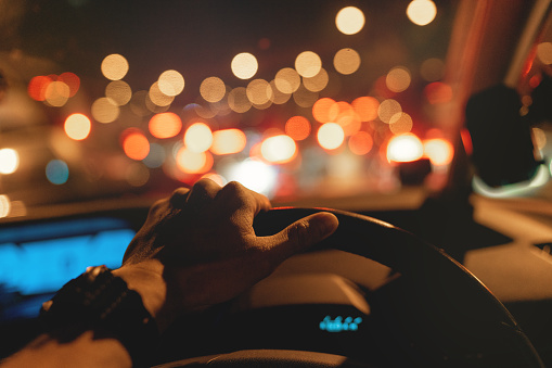 Stuck in traffic jam, left hand on steering wheel