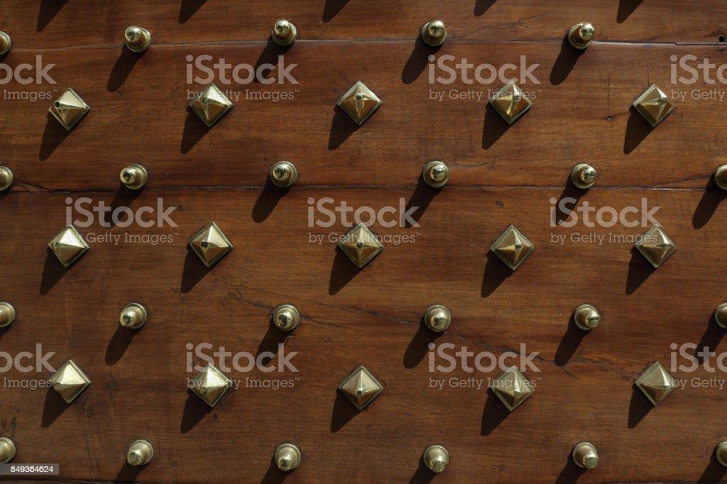 Studded door. stock photo