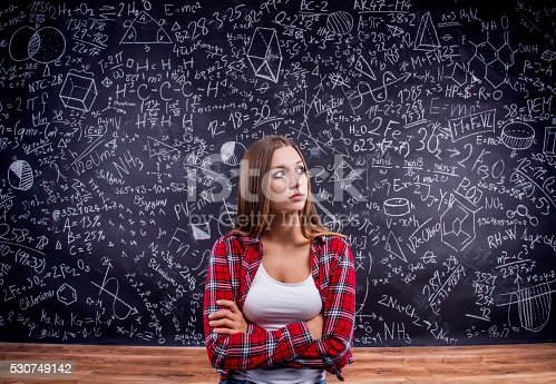 istock Student against a big blackboard with mathematical symbols 530749142