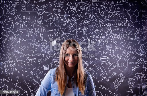 istock Student against a big blackboard with mathematical symbols 530749514