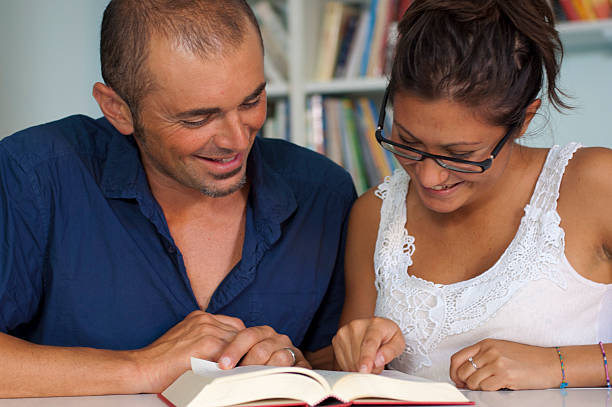 Student and his tutor Student and his tutor illiteracy stock pictures, royalty-free photos & images