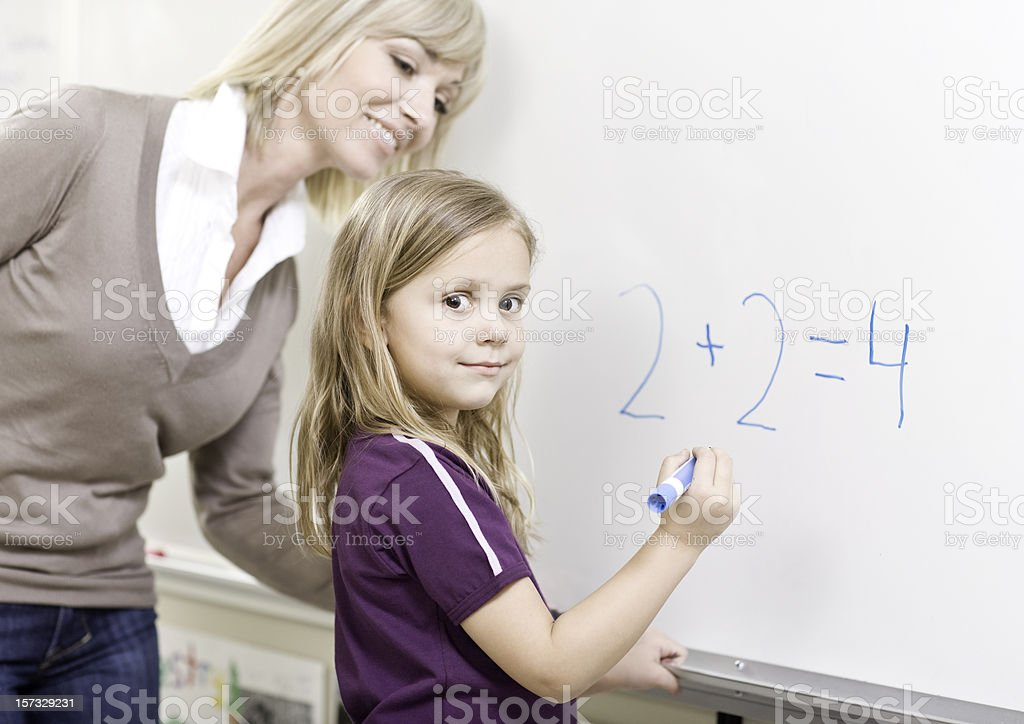 Student and Teacher doing Math royalty-free stock photo