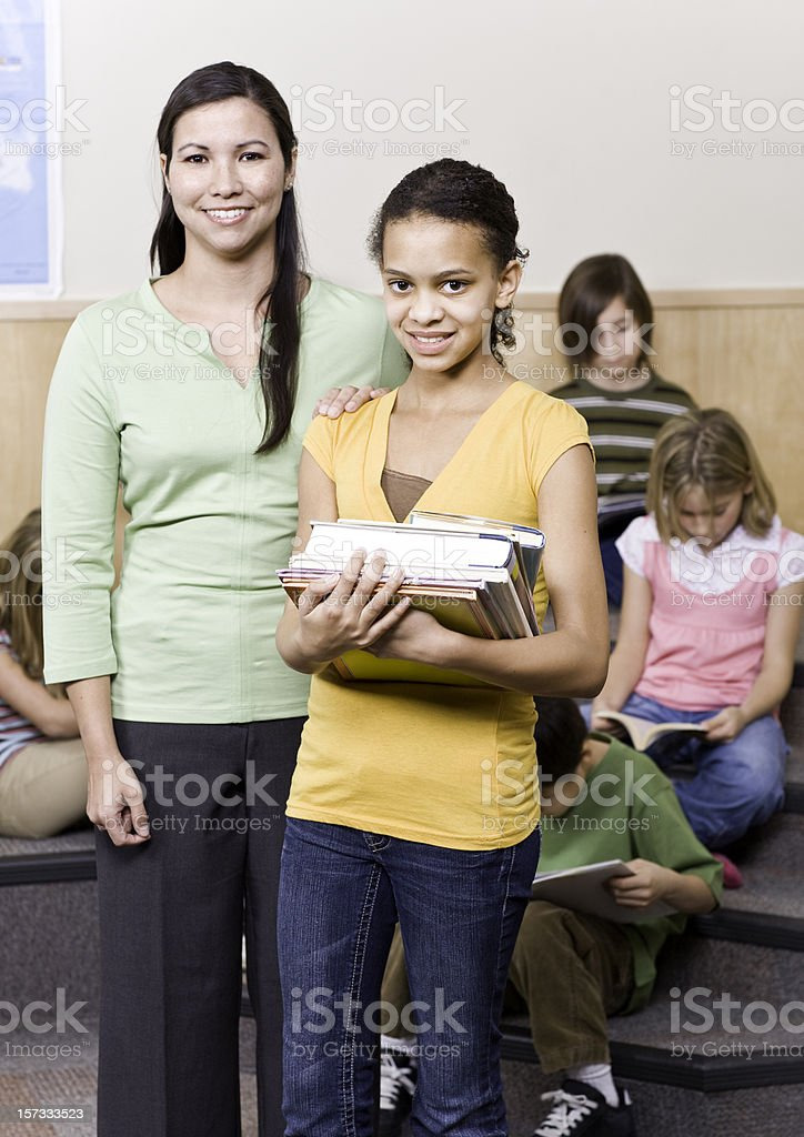 Student and Teacher in Library royalty-free stock photo