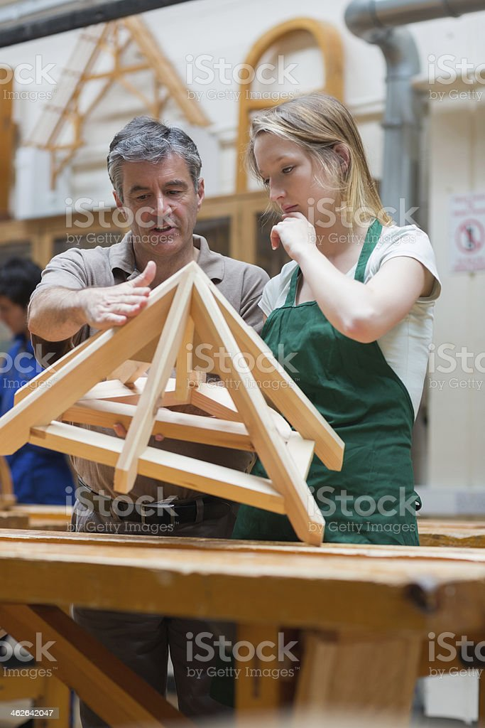 Student and teacher standing in a woodwork class stock photo