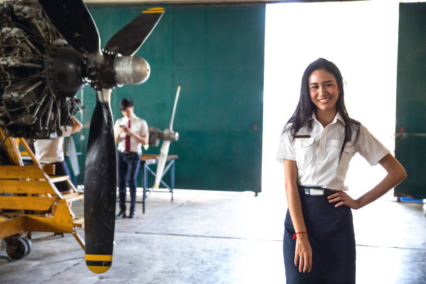 Student at Aviation University in Thailand Aviation student posing inside an hangar at university flight suit stock pictures, royalty-free photos & images