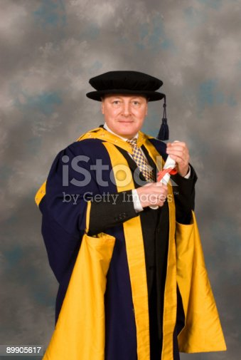 istock PHD student at graduation ceremony in full robes 89905617