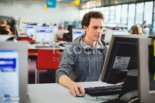 istock student at the computer 497219094
