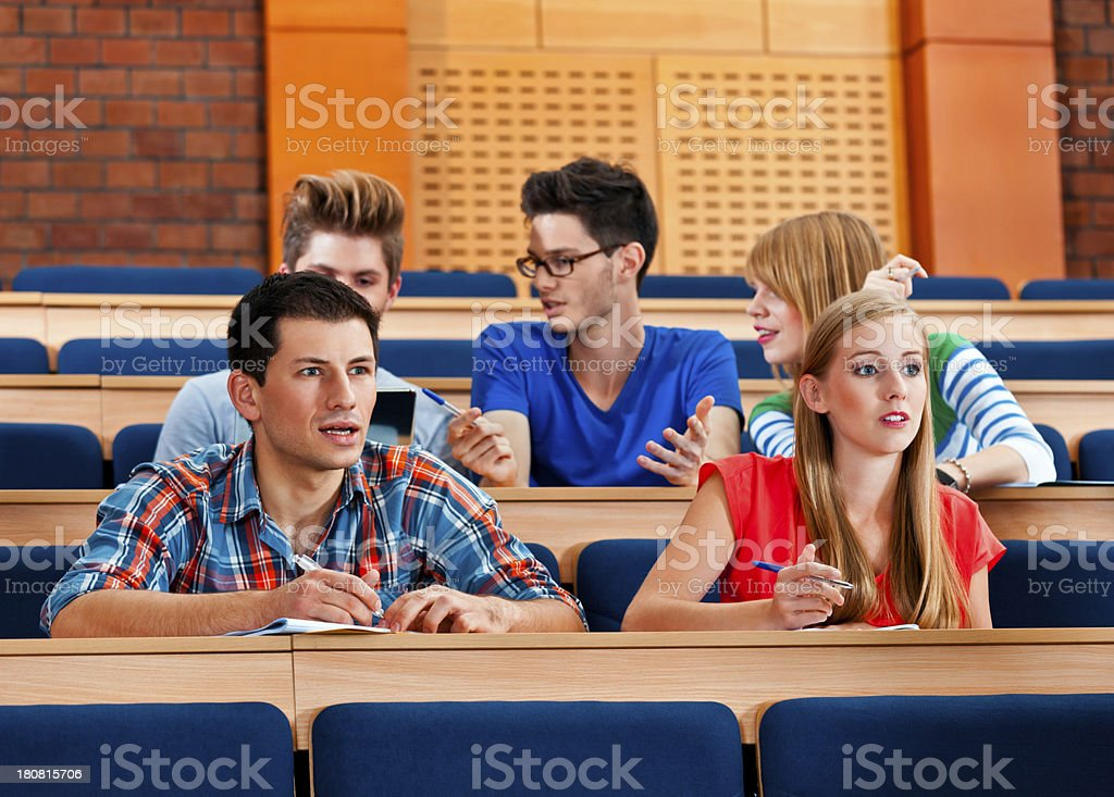 Student at the lecture College students sitting in the lecture hall at the university and listening to the lecture. 20-24 Years Stock Photo