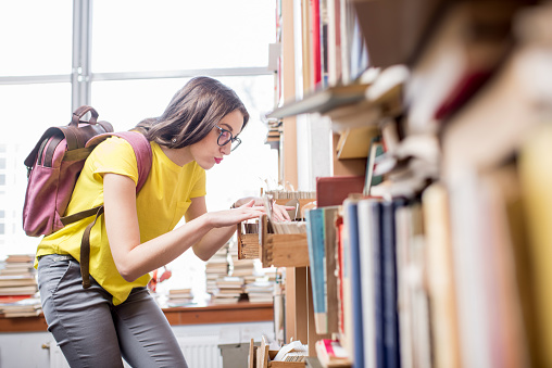 668340340 istock photo Student at the library 654720580