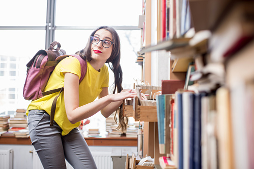 668340340 istock photo Student at the library 654720660