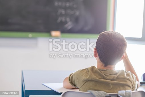 istock Student attending in a  classroom during a lesson 854385926