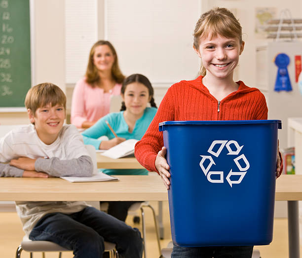 Student Carrying a Recycling Bin stock photo
