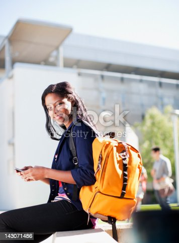 istock Student carrying backpack outdoors 143071486