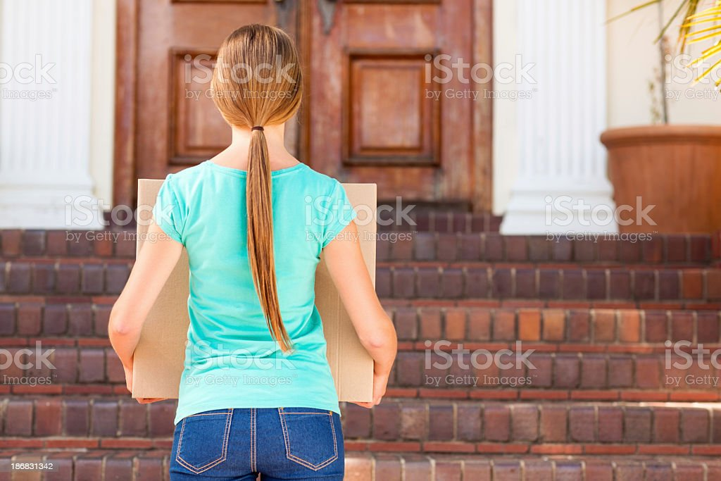 Student Carrying Cardboard Box Into New Dorm royalty-free stock photo