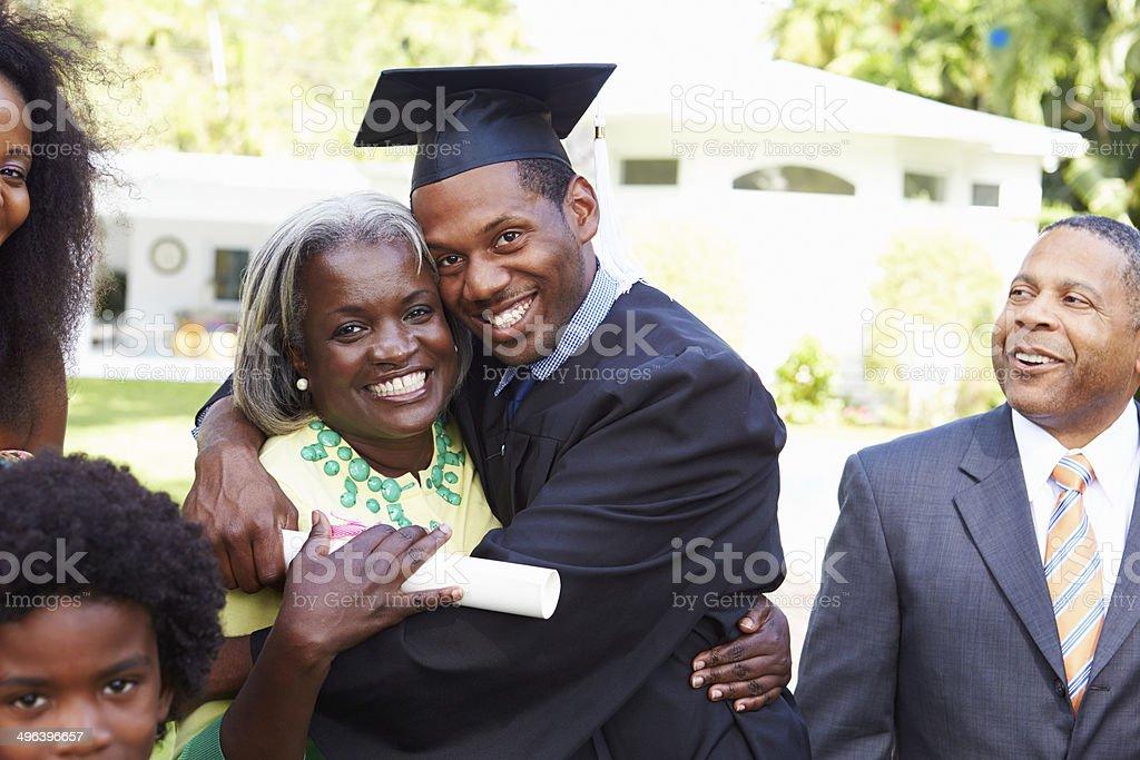 Student Celebrates Graduation With Parents stock photo
