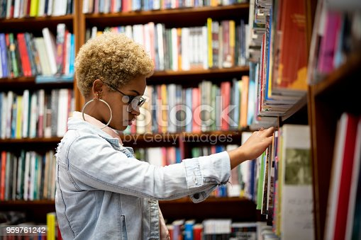 istock Student Choosing a Book on Library 959761242