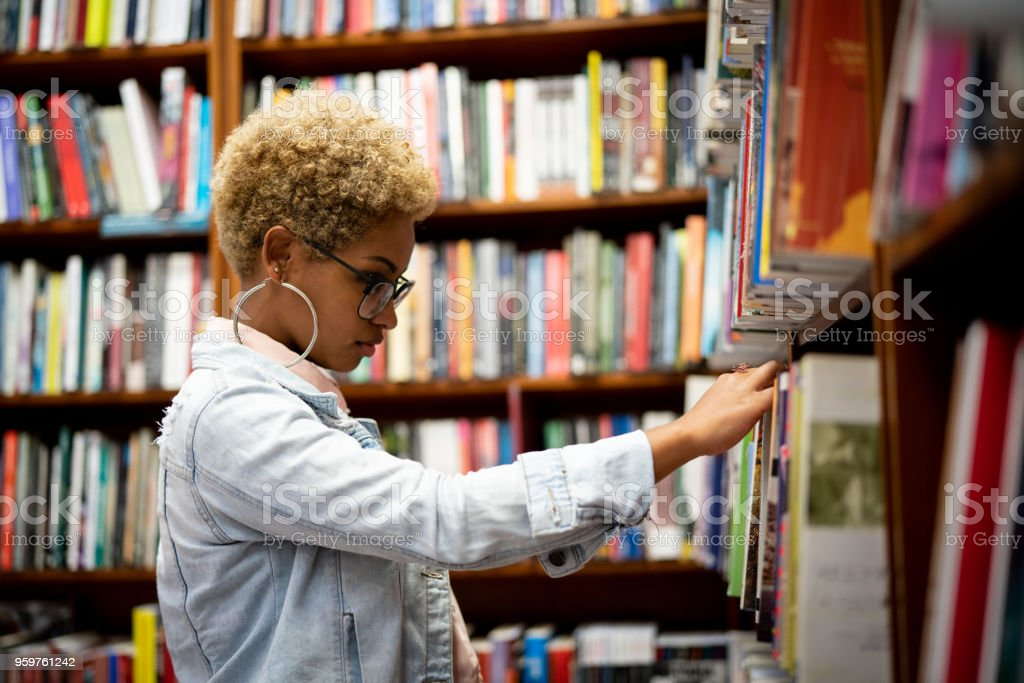 Student Choosing a Book on Library stock photo