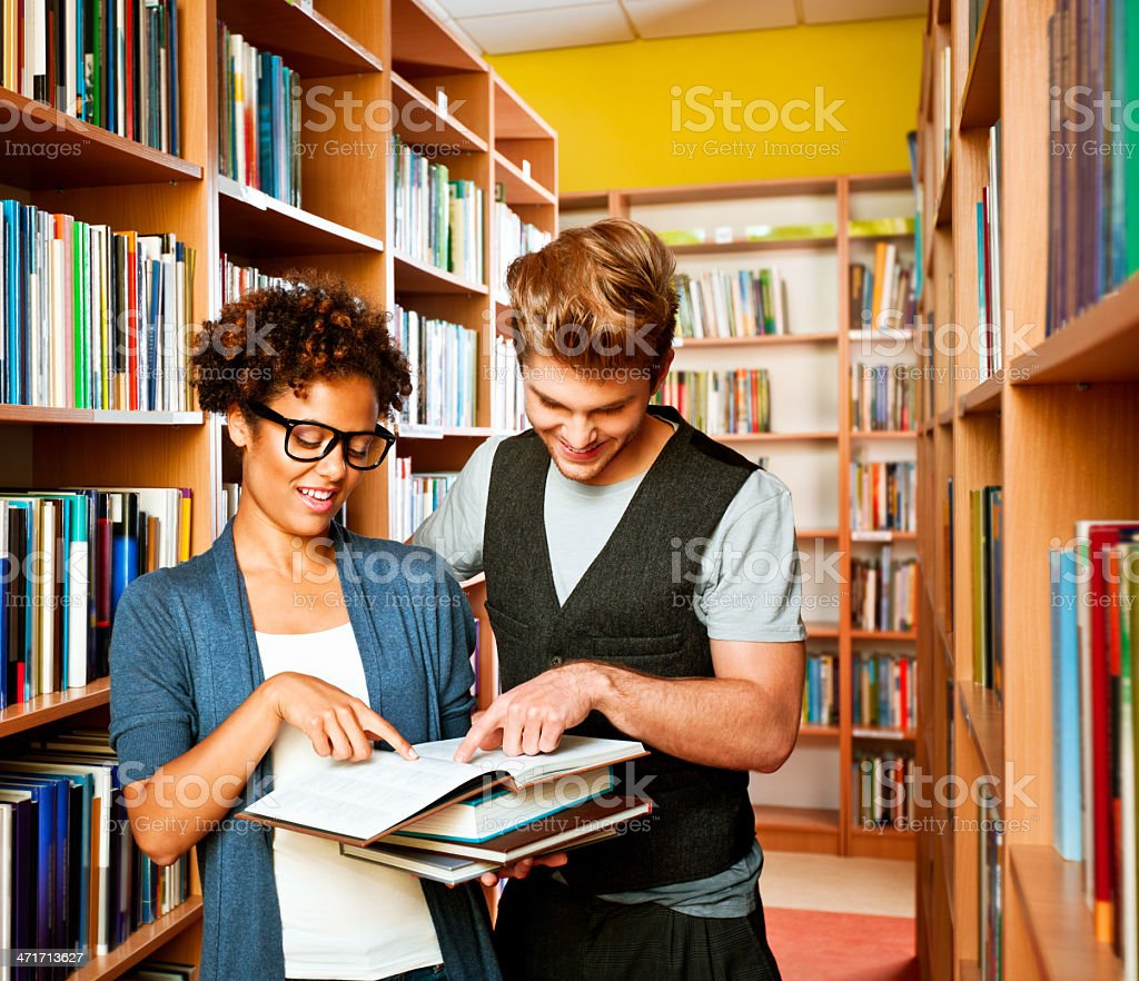 Student choosing books in library royalty-free stock photo