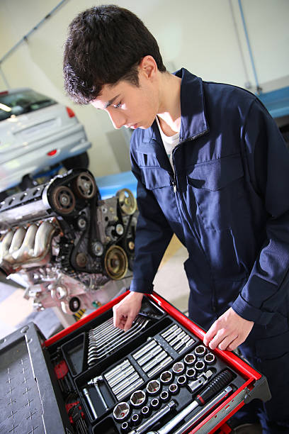 Student choosing the tools in a garage stock photo