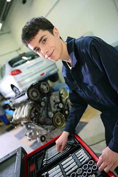 Student choosing tools to repair motor stock photo