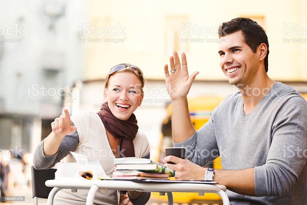 Student couple enjoying a coffee break royalty-free stock photo