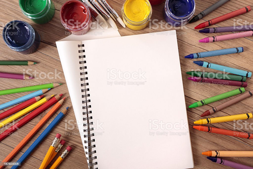 Student desk with folded notebook and school supplies royalty-free stock photo