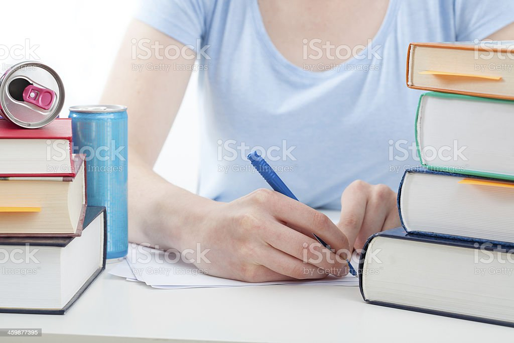 Student doing her homework stock photo