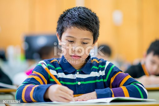 istock Student Doing Homework from His Notebook 507753294