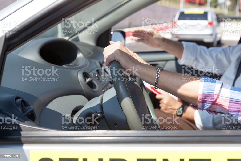 Student driver. Learning to drive a car. stock photo