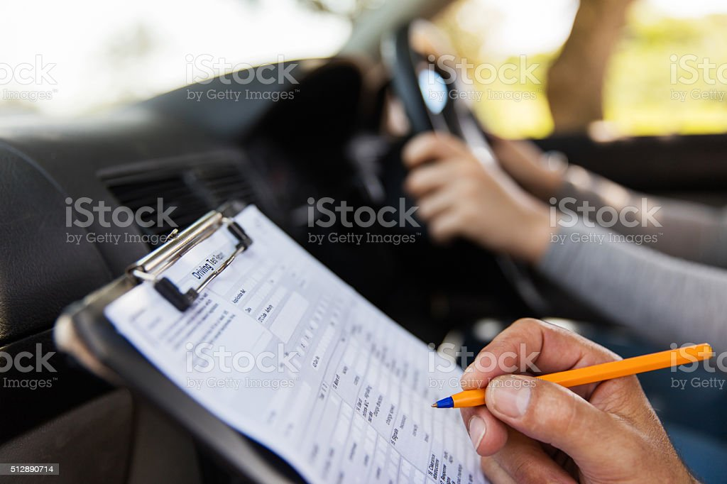 student driver taking driving test stock photo
