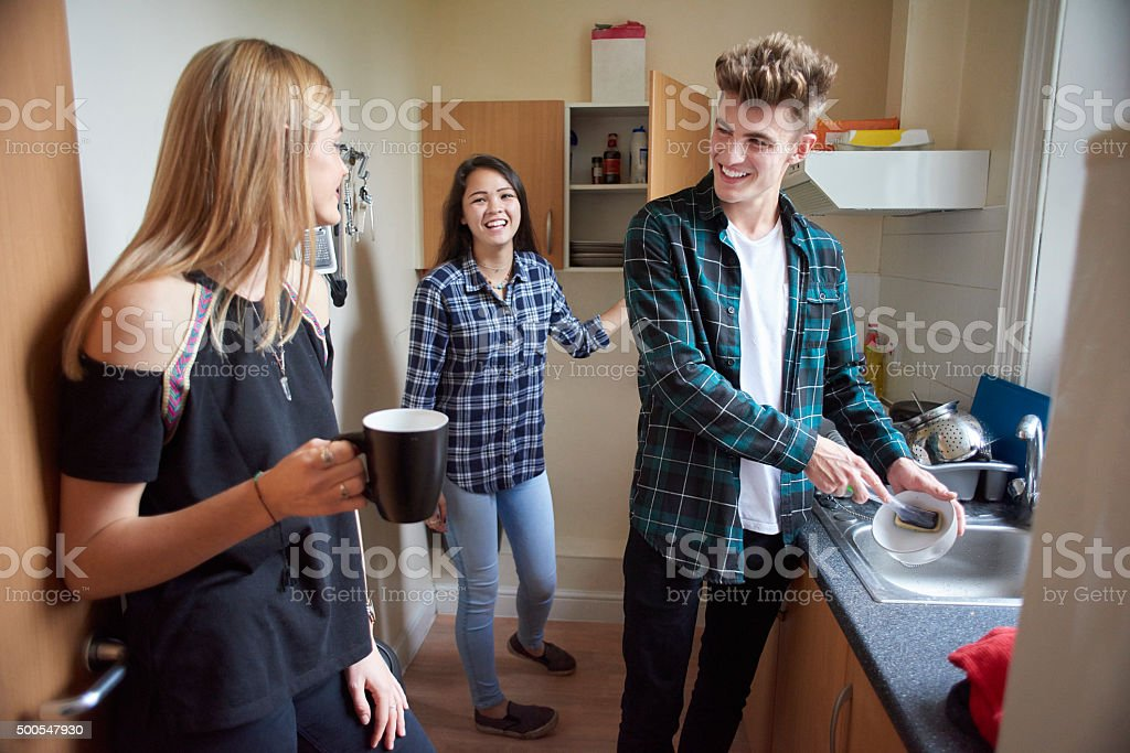 student flatmates in the kitchen stock photo