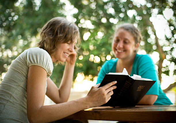 student friends reading the bible - preacher stock photos and pictures