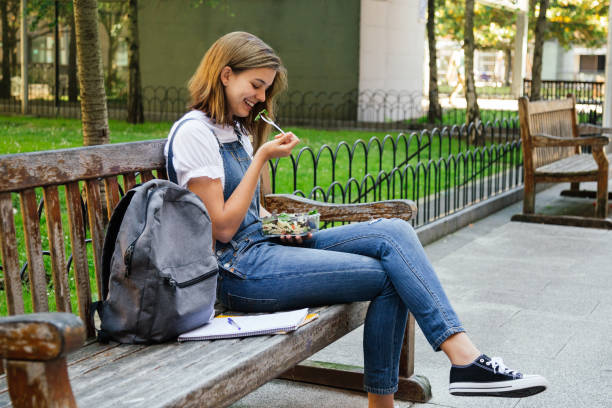 Student girl having healthy lunch stock photo