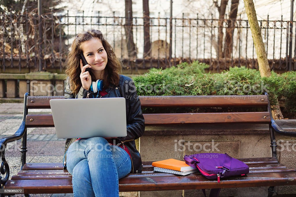 Student girl in the city stock photo