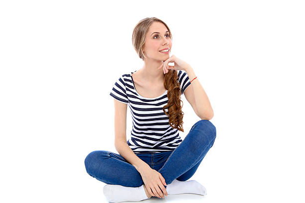 student girl, isolated over background - sitting on floor stock photos and pictures