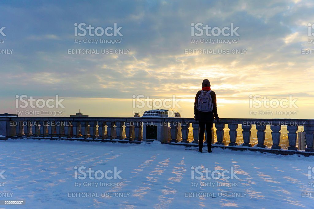 student girl looking at the city of Montreal during sunrise stock photo