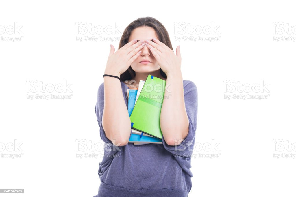 Student girl making see no evil gesture stock photo