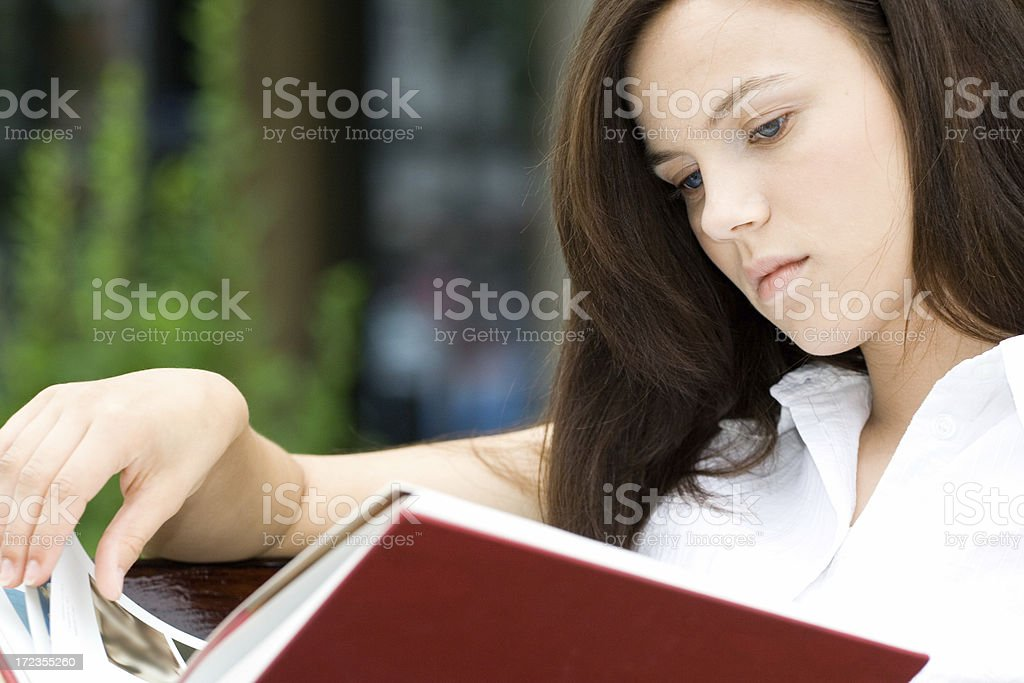Student girl - reading a book royalty-free stock photo