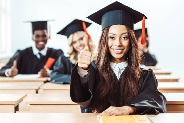 student girl showing thumb up african american student girl showing thumb up at classroom college fair stock pictures, royalty-free photos & images