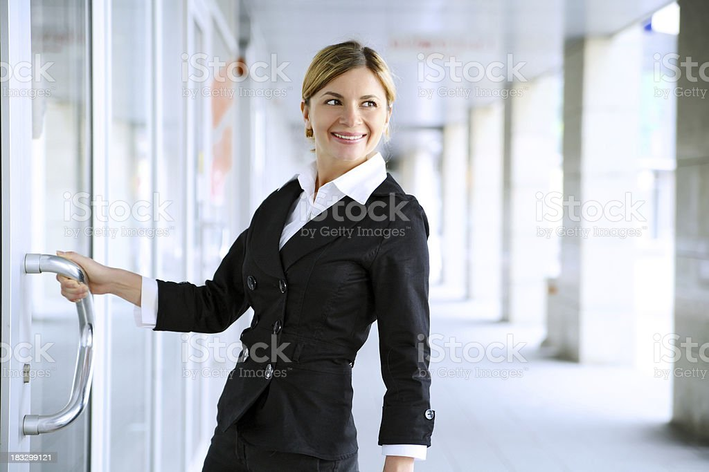 Student girl standing near the door. royalty-free stock photo