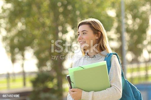 istock Student girl walking outdoors 657452496