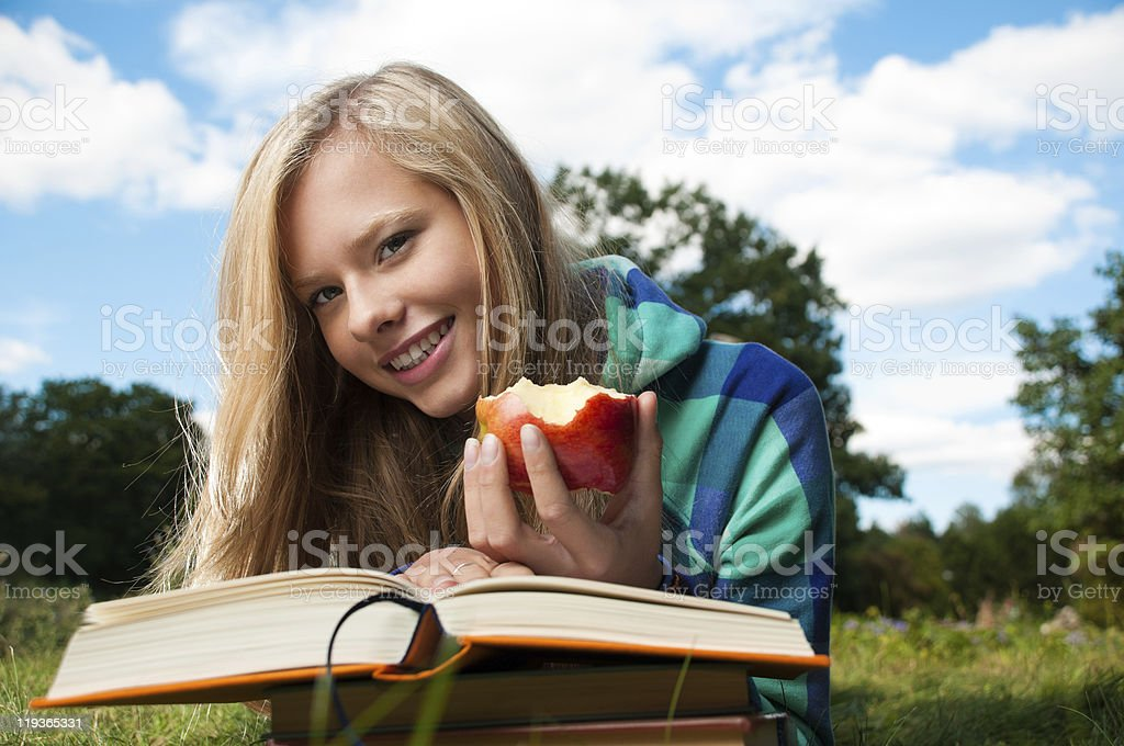 student girl with apple and books royalty-free stock photo