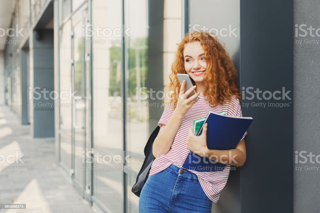 Student girl with books on university background royalty-free stock photo