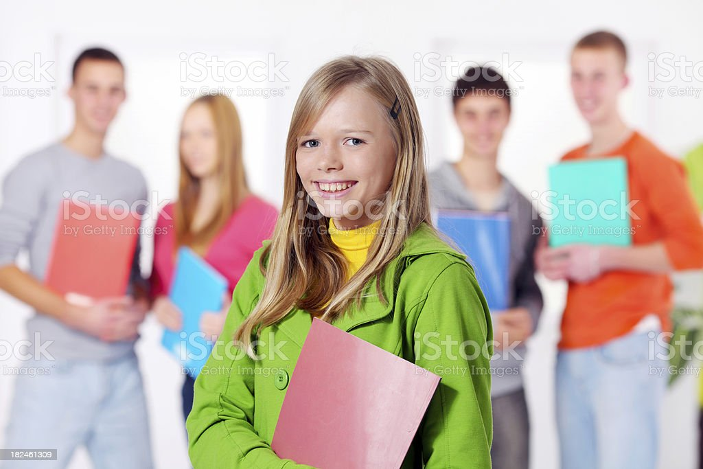 Student girl with exercise book in classroom. royalty-free stock photo